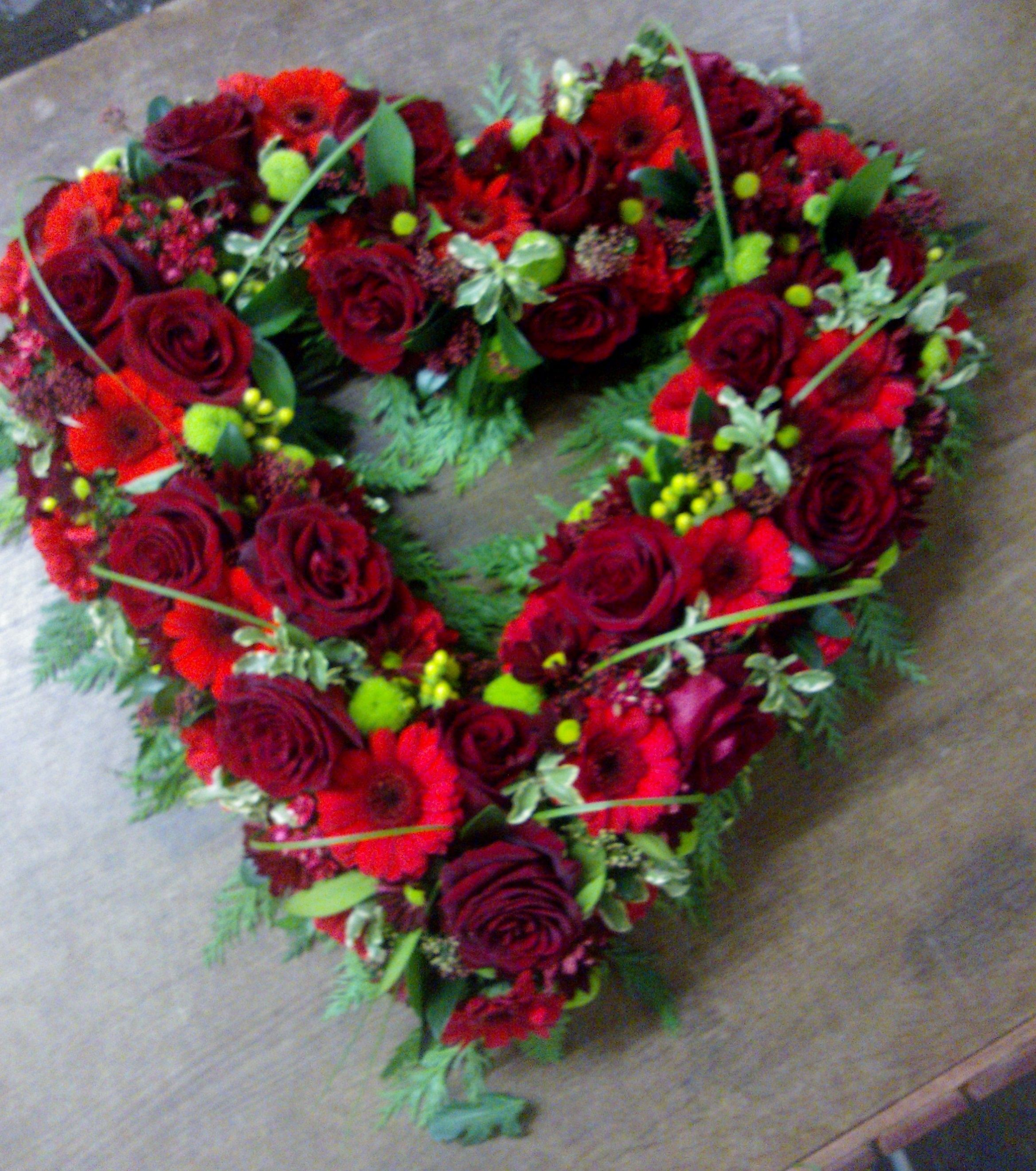 Funeral flowers floralcraft funeral lettering in manchester united colours red gerbera roses carnations and green hypericum izmirmasajfo