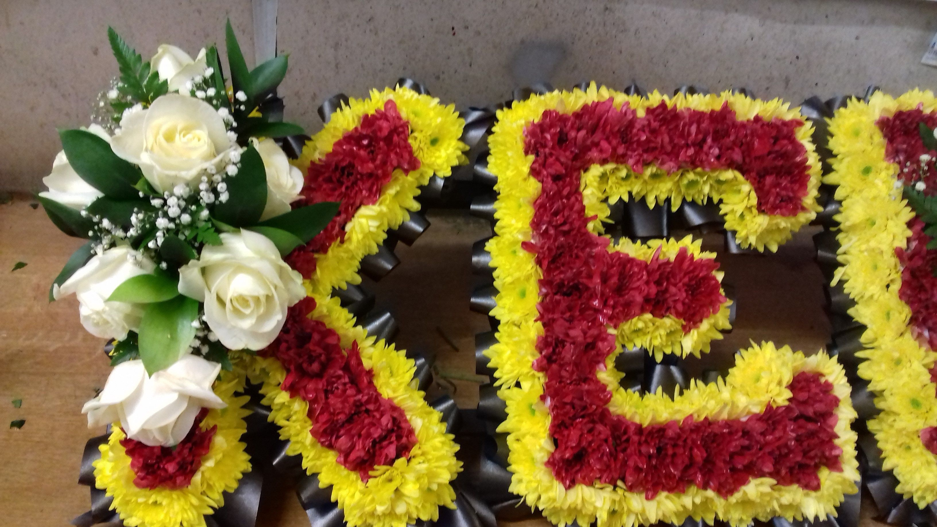 Funeral flowers floralcraft funeral lettering in manchester united colours izmirmasajfo Image collections